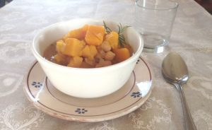 Rustic pumpkin soup with chickpeas and rosemary